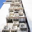 Stock Photo: Air conditioners condenser units at building rooftop