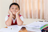 The boy work homework carefully. — Stock Photo