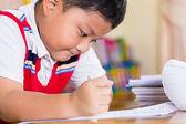 The boy work homework carefully. — Stock Photo