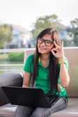 Pretty Asian female adolescents use technology for communication — Stock Photo