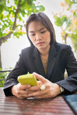 Beautiful Asian business woman using mobile for communication — Stock Photo