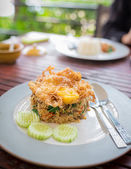 Basil Beef Fried Rice Topped with a fried egg — Stock Photo