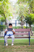 Asian boy playing Tablet fun — Stock Photo