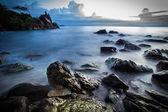 Beach with lots of rocks. Sunset — Stockfoto