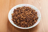 One dish of cereal breakfast without milk on woody table — Foto de Stock