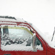 Stock Photo: Snow covers on car's window as snowing weather
