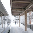 Railway station view with train and one man , snowing in winter — Stock Photo