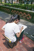 Ben-Yuan Lin Family Mansion and Garden sight view ,one girl sits on chair and draws a tree on paper with pencil — Stock Photo