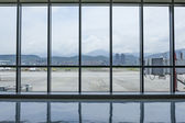 Taipei Songshan Airport Terminal interior sight with outside — Stok fotoğraf