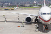 Airport ground handing operations on tarmac in Taipei SongShan A — Stock Photo
