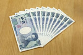 Eight peices of one thousand Japanese cashes close up — Foto de Stock