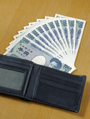 Ten peices of one thousand Japanese cashes wallet close up — Photo