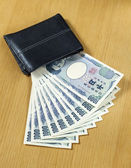 Ten peices of one thousand Japanese cashes wallet close up — Foto de Stock