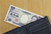 One peice of five thousand Japanese cashes wallet close up — Photo
