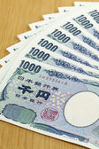Eight peices of one thousand Japanese cashes close up — Stock Photo