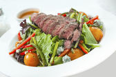 Veggy salad with meat on table  close up  — Stock Photo