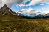 Typical alpine meadow framed by rocky alpine massifs — Stock Photo
