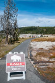 Warning sign in nature path. — Stock Photo