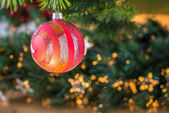 Beautifully lit red christmas ball. — Stock Photo