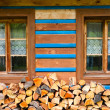A small windows in the wall of an old wooden house. — Stock Photo #42388337