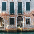 Scenic old houses along a canal in Venice, the lagoon of Italy — Stock Photo #50796455