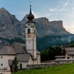 Mountain Church in the Alpine village. — Stock Photo #50864587