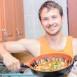 Man cooking paella — Stock Photo