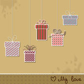 Five presents hanging from above — Stock Vector