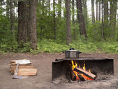 Cook pot over camp fire — Stock Photo