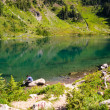 Stock Photo: WomFiltering Water at Alpine Lake
