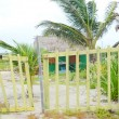 A wooden gate in front of a simple beach hut in Mahahual, Mexico. — Stock Photo #28168961
