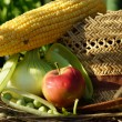 Peas, corn, apple and ears of wheat — Stock Photo