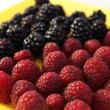 Blackberries and raspberries on a platter — Stock Photo