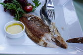 Delicious grilled fish on a plate. — Stock Photo