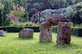 Garden and Stones looking like Stonehenge. — ストック写真