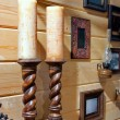 Stock Photo: Two decorative wooden candlestick on mantelpiece