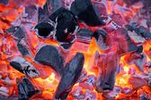 Glowing charcoal and flame in BBQ — Stock Photo