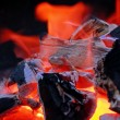 Stock Photo: Glowing charcoal and flame in BBQ