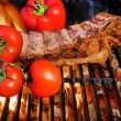 Stock Photo: Pork Ribs in flame in BBQ Grill
