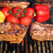 Pork Ribs, brisket, belly roasted in BBQ with vegetables — Stock Photo
