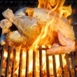 Grilled chicken in flames — Stock Photo