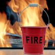 Stock Photo: Fire bucket and Flames