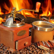 Hot mug of coffee by the fire — Stock Photo