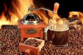 Hot mug of coffee by the fire — 图库照片