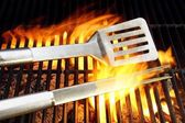 BBQ Utensils and Hot cast iron grate XXXL — Stock Photo