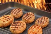 Burger put on the grill pan XXXL — Stock Photo
