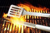 BBQ Utensils and Hot cast iron grate XXXL — Stock Photo