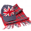 Souvenirs from London. Baseball cap and tartan scarves — Stock Photo #51772741