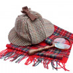 Deerhunter or Sherlock Holmes cap cap, magnifying glass, tartan — Stock Photo #51774107