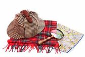 Deerhunter cap, magnifying glass, tartan scarves and London map — Stock Photo
